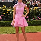In 2014, Gigi made an appearance at the Melbourne Cup in Australia in a lacy pink look with a matching fascinator.