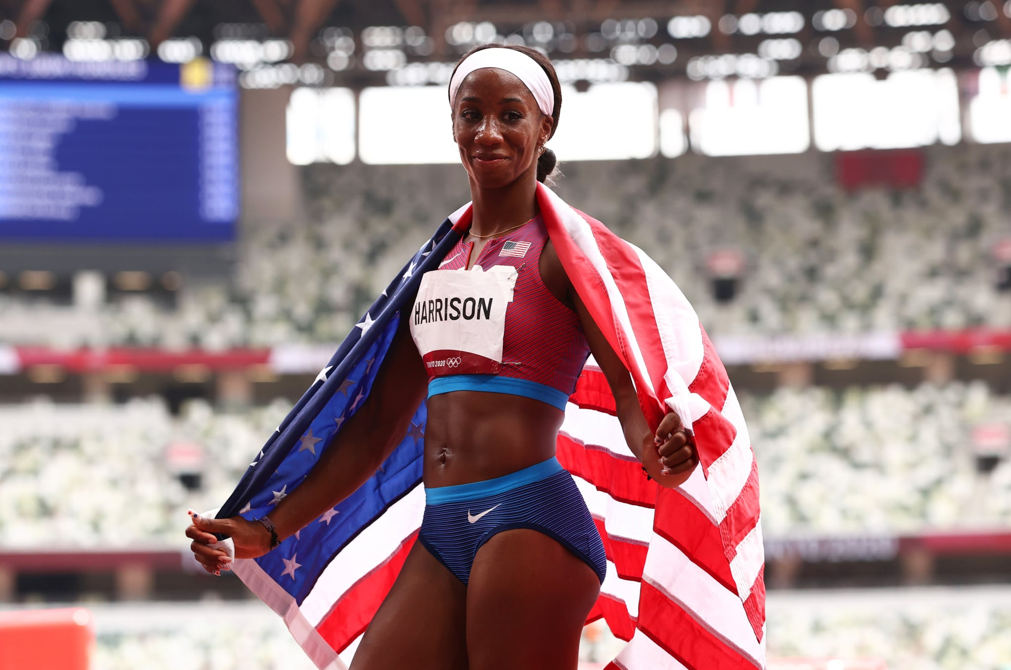 TOKYO, JAPAN - AUGUST 02: Kendra Harrison of Team United States reacts after winning the silver medal in the Women's 100m Hurdles Final on day ten of the Tokyo 2020 Olympic Games at Olympic Stadium on August 02, 2021 in Tokyo, Japan. (Photo by Ryan Pierse/Getty Images)