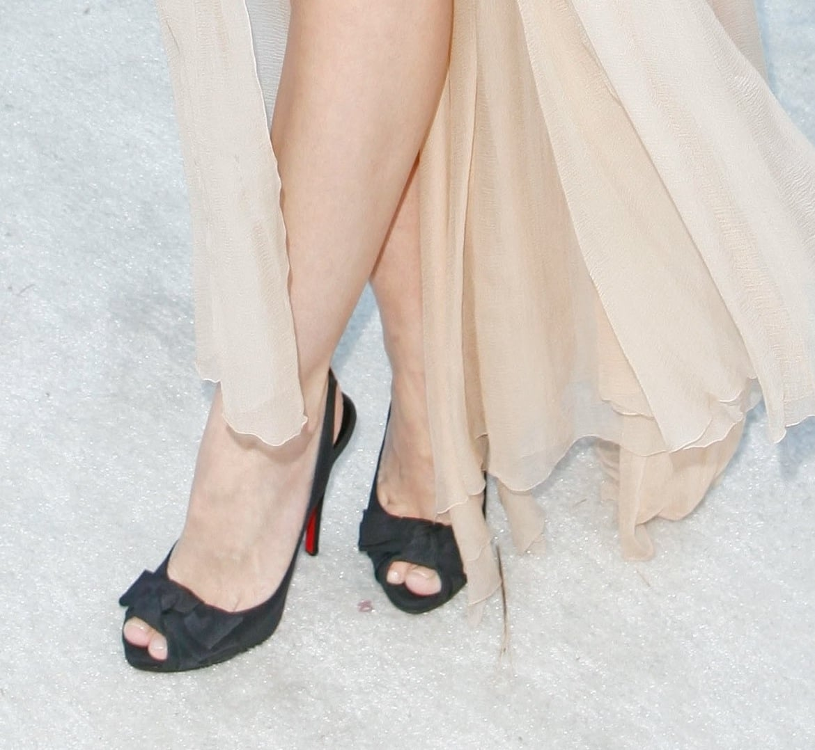 Outside Elton John's soiree, Jaime King showed off her Christian Louboutin slingback peep-toes embellished with adorable bows.