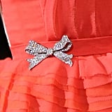 A closeup of Michelle Williams's pretty bow-adorned belt.
