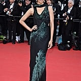 Zoe Saldana wore a green and black Jason Wu dress to the Mr. Turner red carpet.