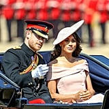 Meghan stunned in this sugar-pink Carolina Herrera off-the-shoulder dress at Trooping the Colour in 2018, topped off with a Philip Treacy hat.