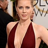 Amy Adams played to the '70s theme of American Hustle with a long yellow gold diamond Lorraine Schwartz pendant necklace to accentuate that plunging neckline.