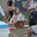 Emma Roberts relaxed in the grass with a group of friends at Coachella's second weekend.