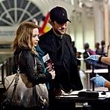 Emily Blunt Jets Off to Join Matt Damon With John Krasinski by Her Side