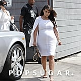 Kim Kardashian wore a white caped dress in LA.