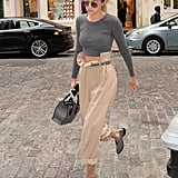 Gigi Hadid's paperbag trousers look good with a crop top or a shirt tucked in à la Kendall Jenner.