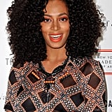 Solange Knowles layered her peach and black beaded piece over a printed collared blouse.