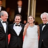 Marion Cotillard blew kissed on the carpet as she posed with Jean-Pierre Dardenne, Fabrizio Rongione, and Luc Dardenne.