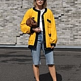 Switch up your proportions for opting for knee-length denim shorts and an oversize cardigan sweater.