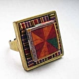 This origami-inspired ring combines clean lines, bold colors, and of course, sustainable practices. Set in a nickel- and brass-free ring, these recycled decorative papers offer sleek designs. Pinwheel and Stripes Geometric Eco Chic Paper Ring ($16)