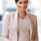 ‎Meghan Markle Carrying a Carolina Herrera Metropolitan Insignia Small Clutch Bag in White