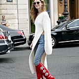 Choose an asymmetrical sweater dress that lifts on one side to reveal your shoes.