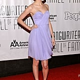 Taylor chose a soft lilac dress, nude pumps, and a sweet braided updo for a June 2010 event.