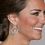Kiki's blue topaz and diamond Lola circle earrings have become a favorite of Kate's. She wore them to the Diamond Jubilee concert, the opening ceremony of the London Olympics, and an evening reception in New York in 2014.