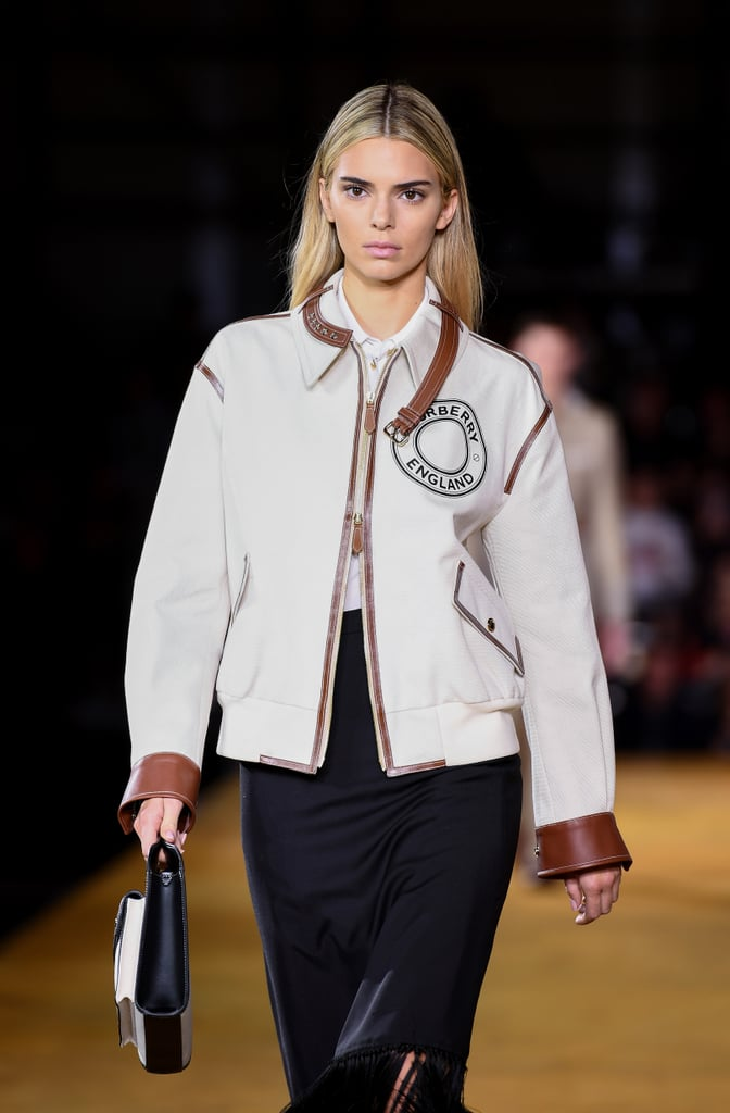 Kendall Jenner is back on the runway — and as a blonde. After opting not to walk the runway during New York Fashion Week, the model and reality star appeared in Burberry's Spring 2020 show at London Fashion Week with a striking new hair color that makes her look a lot more like Khloé than Kim Kardashian. It's likely that Jenner was actually wearing a wig, or maybe the hair dye is temporary, but it also isn't the first time she's experimented with blond. Jenner previously swapped shades with Gigi Hadid at a Balmain show in 2016, and she shared a selfie in a blond wig the previous year. Perhaps she's finally taken the plunge? See photos of the lightened-up look ahead.