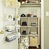 """With the closet right next to the dresser, I hung an over-the-door storage system so that I could quickly grab whatever I needed while changing diapers. The best part is that it didn't take up any additional space! We stuck the same cubby bookcase that we used for toy storage between the bed and crib for extra clothing storage in the closet. The square-shaped cubbies accommodate any 13""""x13"""" storage bins, which can easily be found for less than $10 a bin. They're perfect for corralling shoes, hats, and other bulky items."""