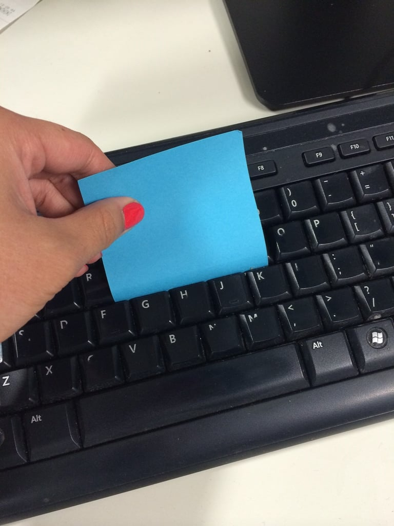 Clean Your Keyboard With a Post-It Note