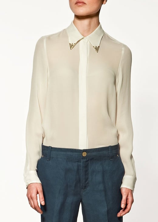 A basic white blouse with a chic metal collar detail.  Zara Studio Shirt ($100)