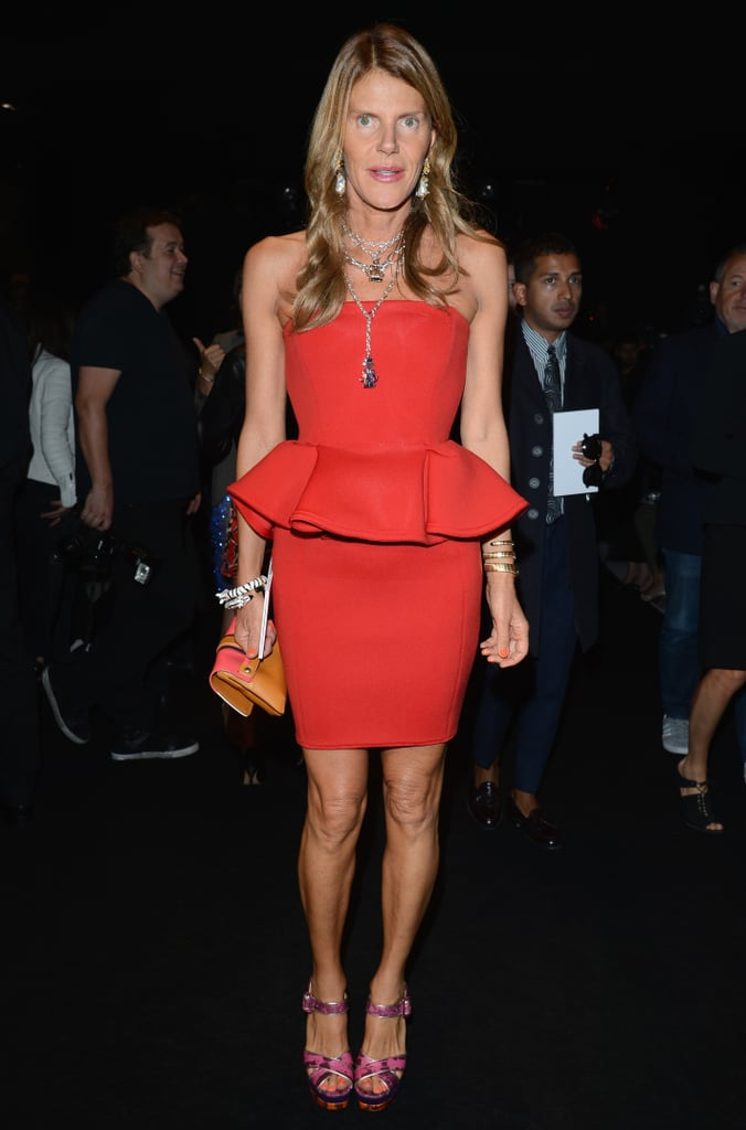 Anna Dello Russo dressed to kill — or rather, impress — in a red peplum number at the Gucci Spring '13 show in Milan.