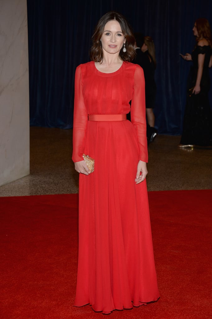 Emily Mortimer chose a brilliant red chiffon gown, which she paired with Kwiat diamond drop earrings and an embellished minaudière in hand.