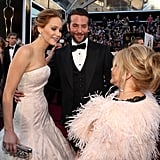 Jennifer Lawrence and Bradley Cooper chatted with Bradley's mom on the carpet.