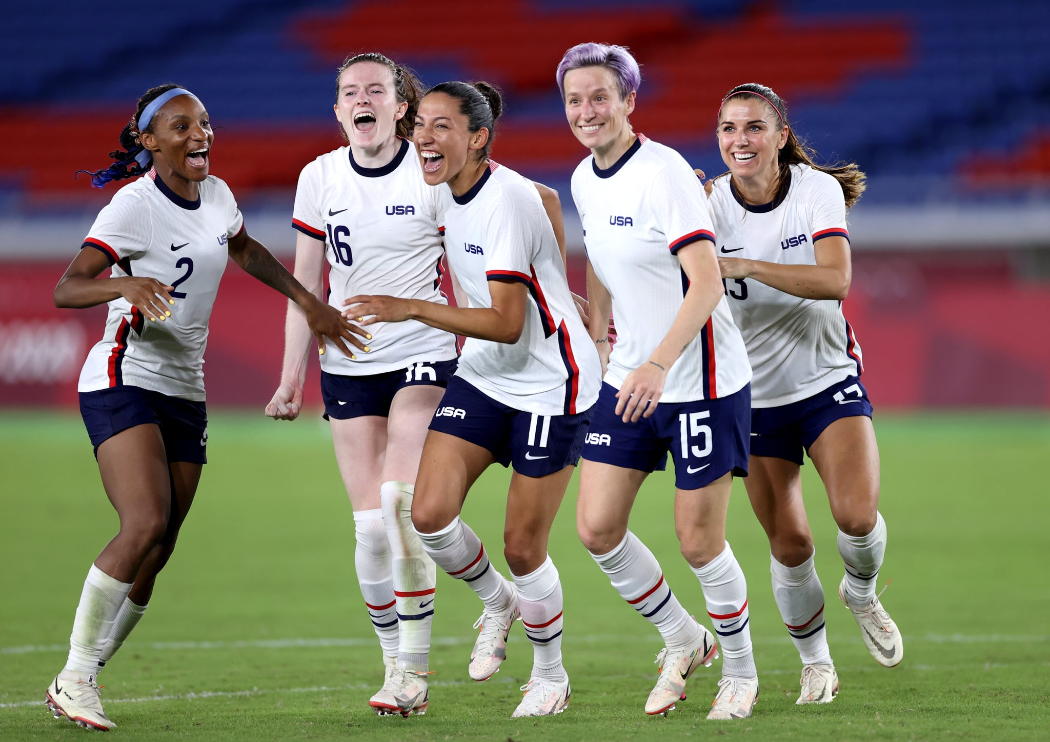 YOKOHAMA, JAPAN - JULY 30: Crystal Dunn #2, Rose Lavelle #16, Christen Press #11, Megan Rapinoe #15 and Alex Morgan #13 of Team United States celebrate following their team's victory in the penalty shoot out after the Women's Quarter Final match between Netherlands and United States on day seven of the Tokyo 2020 Olympic Games at International Stadium Yokohama on July 30, 2021 in Yokohama, Kanagawa, Japan. (Photo by Laurence Griffiths/Getty Images)