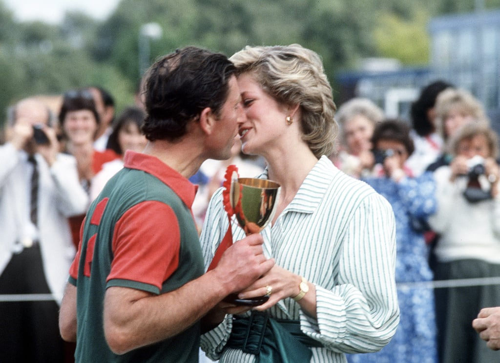 Princess Diana and Prince Charles kissed after a 1985 charity polo match in Windsor, England.