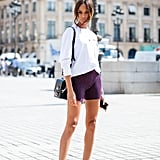 Pair Biker Shorts With a White Sweatshirt and Red Heels
