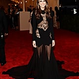 Allison Williams hit the red carpet in an edgy sheer and lace gown by Joseph Altuzarra.