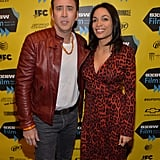 Nicolas Cage posed for a photo with Rosario Dawson at the premiere of Joe on Sunday.