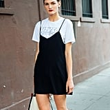 For the most classic of t-shirt and dress looks, throw a black silk slip dress over a vintage printed tee.
