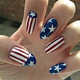 These talon-like nails are perfect for showing off your stars and stripes. Source: Twitter user emilyisabella26