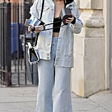 Two words: Canadian tuxedo. Bella gave it a 2017 spin, however, with a black crop top and chokers. Everything about her outfit, from the over-size jacket to the flared pants, screamed casual and cool.