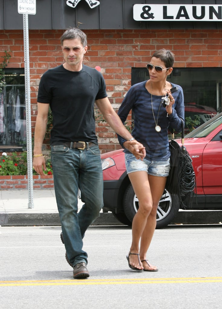 Halle Berry and Olivier Martinez hurried across the street.