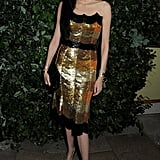 L'Wren Scott stepped out in a shiny dress for the London Fashion Week event.