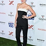 Miley Cyrus stayed true to her sexier aesthetic — albeit with a more sophisticated angle — in a black-and-white strapless Valentino jumpsuit and Saint Laurent sandals at the Maxim Hot 100 party in LA.