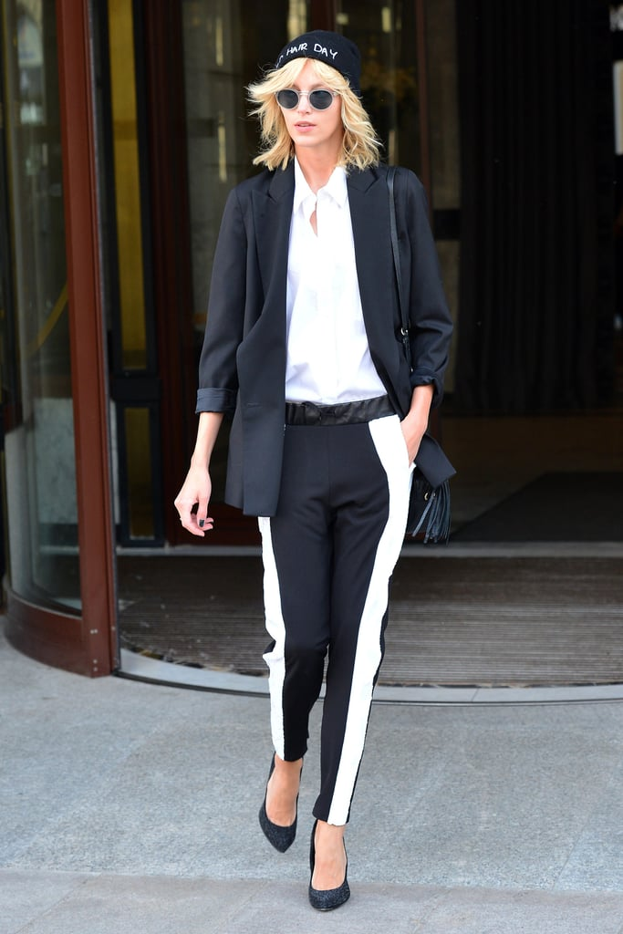 Anja Rubik made the streets of Warsaw stylish with her tuxedo-inspired ensemble, topped with a beanie and round sunglasses.