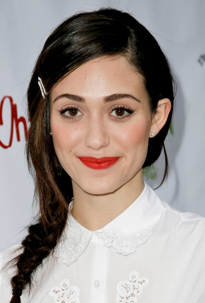 Leave it to Emmy Rossum to teach our followers how to hide overgrown bangs in a way that's both fashionable and functional.