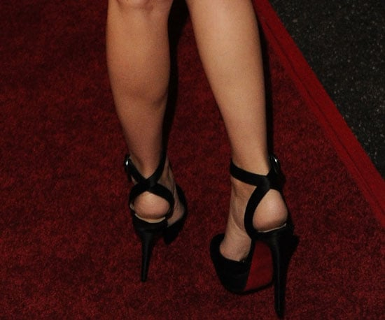 And ankle-strap, satin Louboutins.