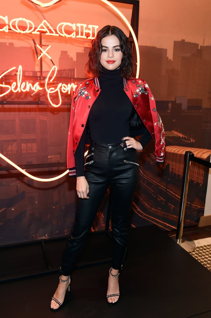 "A day after Selena Gomez attended Coach's Spring '18 show in NYC, she held an in-store event to meet her fans. The singer chose a classic black outfit: a turtleneck top, leather pants with zipper details, and studded black heels from Stuart Weitzman. For a pop of color to match her lipstick, Selena sported Coach's embroidered red varsity jacket and Jennifer Fisher hoop earrings. She draped the outerwear over her shoulders for that cool-girl touch and even met up with Coach designer Stuart Vevers for another quick photo op.    This particular outfit spoke to Selena's on-trend street style, and of course it's no surprise she is repping Coach. She previously designed a bag for the brand and was even the face of its Fall 2017 campaign. Selena's the ultimate ""Coach girl,"" a statement that's hard to argue against. Read on to see her full look, then shop similar selections ahead."