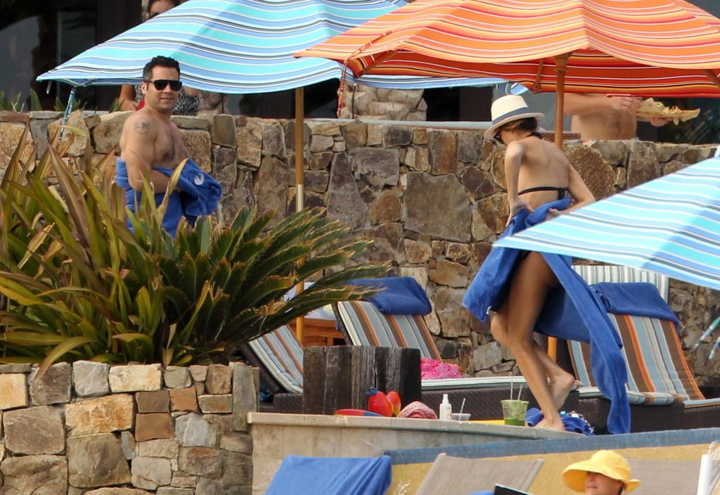 Jessica Alba went for a dip in a pool.