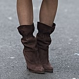 Slouchy brown booties provided a boho feel.