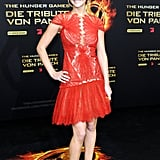 Jennifer Lawrence added to the drama of her little Marchesa dress with a pair of pumps in the same fiery-red hue.