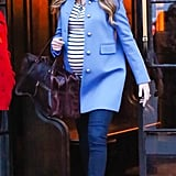 Blake let her growing baby bump take center stage in a classic striped t-shirt-and-jeans combination. She amped up the sophistication with a chic tailored coat and a statement necklace that amplified its shade.