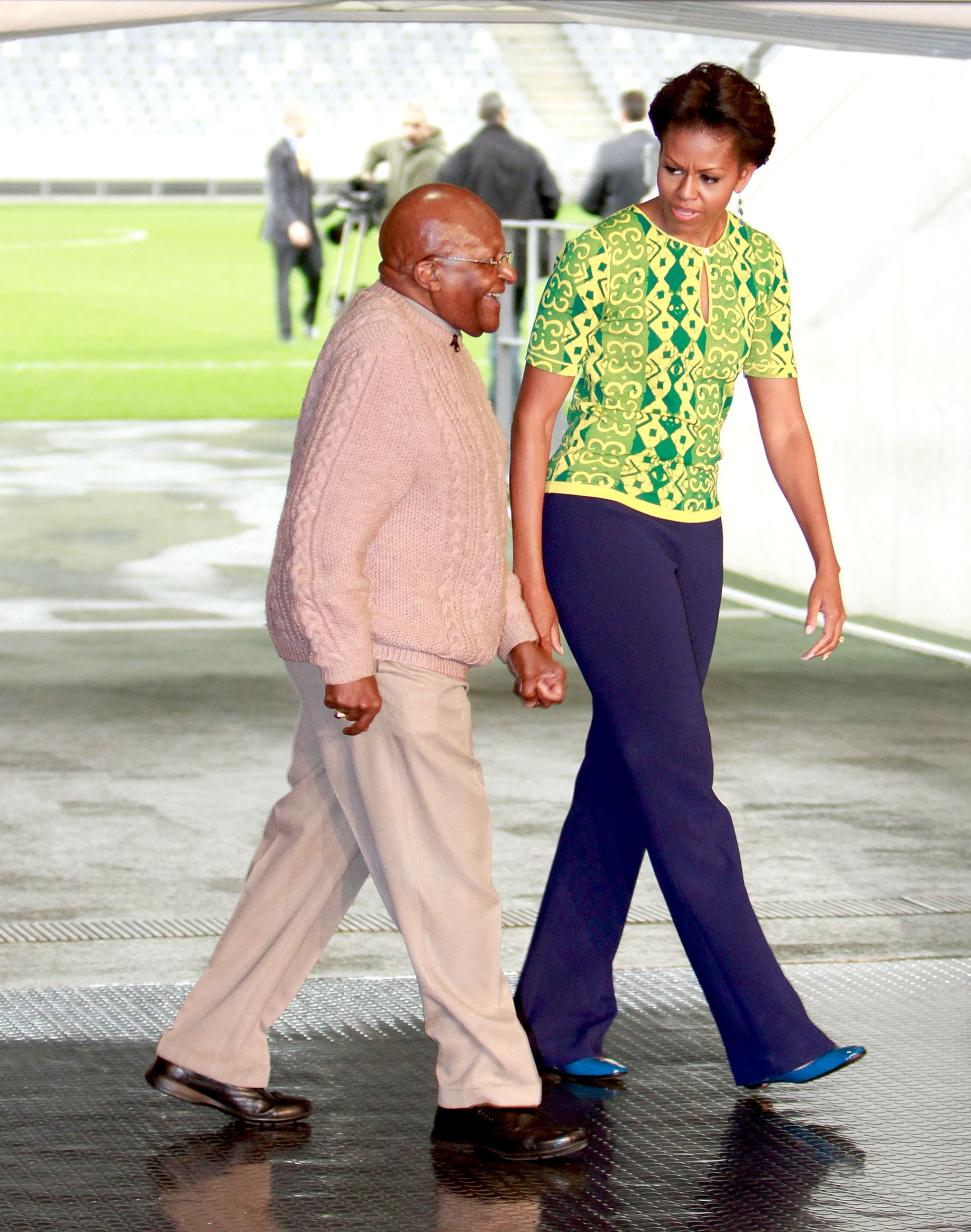 We're loving this printed neon blue-and-yellow Duro Olowu top and navy pant combo Michelle wore during her trip to South Africa.
