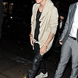 Justin Bieber wore black leather pants and a sweater in London.