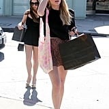 Ashley Benson matched a floral miniskirt with a black top and cap-toe flats while shopping in Studio City.