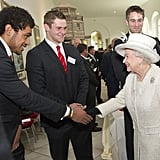 Queen Elizabeth II shook hands with Welsh rugby player Toby Faletau during a visit to Margam Country Park on April 26 in Margam, Wales.