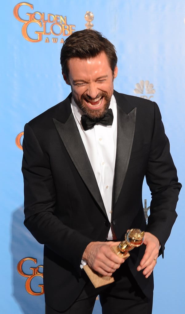 Hugh Jackman held on to his trophy in the Golden Globes press room.